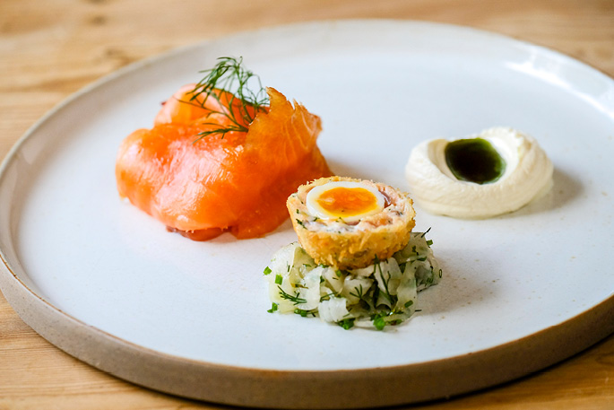 Cold smoked salmon with hot smoked salmon scotch egg and pickled fennel