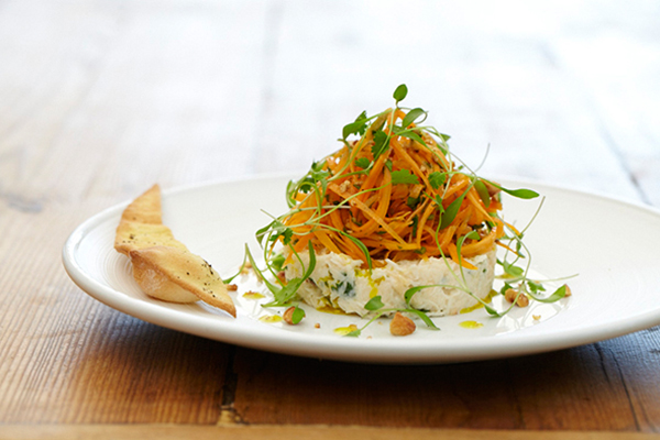 Crab, carrot and coriander salad with toasted hazelnuts and sea salt flat bread