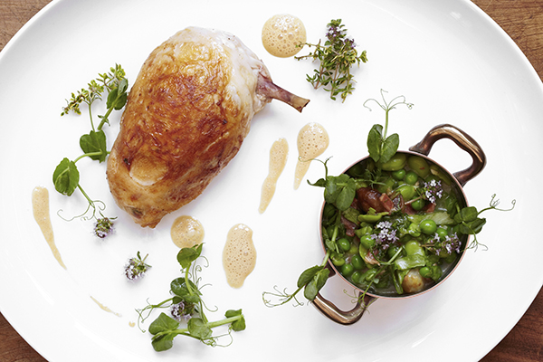 Stuffed Roast Breast of Chicken with Braised Peas and Broad Beans, Crispy Smoked Bacon and Garden Thyme